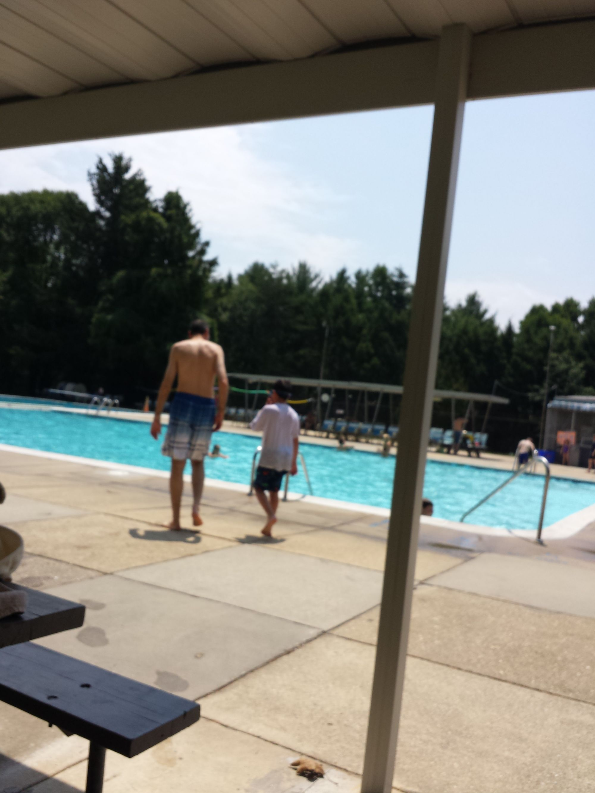 Evonne's husband and older son enjoying the pool membership they were gifted.